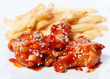 French Fries And Chicken In Tomato Sauce Royalty Free Stock Photos