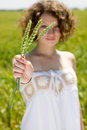 Free Young Girl Holding A Ear Of Wheat Stock Photography - 25159372