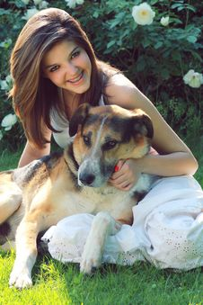 Free Smiling Teenager With Her Dog Stock Image - 25153991