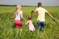 Free Young Family Running Across The Field Royalty Free Stock Photos - 25159398