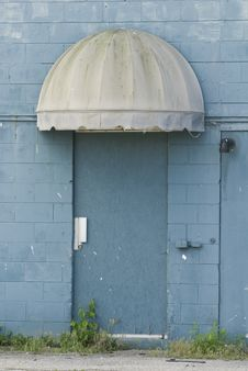 Free Blue Door Under An Old Canopy Royalty Free Stock Images - 25160449
