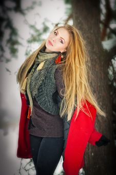 Free Blonde Girl With Red Coat In Winter Snow Royalty Free Stock Photos - 25160708