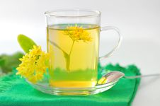 Free Cup Of Linden Tea And Flowers Royalty Free Stock Photos - 25165458
