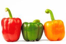 Free Three Multi-colored Paprikas On The White Stock Photos - 25170073