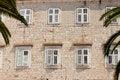 Free Stony Wall And White Windows Stock Photo - 25194950