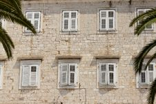 Free Stony Wall And White Windows Stock Photo - 25194950