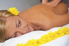 Young Beautiful Woman Enjoying Massage Royalty Free Stock Image