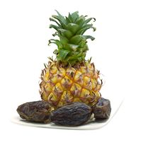 Free Ripe Pineapple And Dates On The White Stock Photography - 25196702