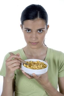 Free Girl Eating Cornflakes Royalty Free Stock Photo - 2523205