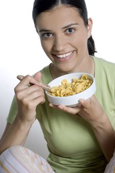 Free Girl Eating Cornflakes Royalty Free Stock Photos - 2523398