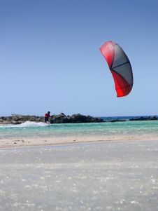 Free A Beach And A Kitesurfer Stock Photography - 2523642