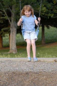 Free Girl Swinging At Park Stock Images - 2528774
