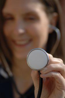 Free Nurse Holding A Stethoscope Royalty Free Stock Photos - 2529168