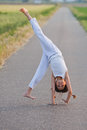 Free Young Girl Makes A Cartwheel Royalty Free Stock Photo - 25201375