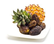 Free Ripe Pineapple And Dates On The White Stock Photography - 25204332