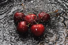 Free Red Cherries In Water Stock Photos - 25213233