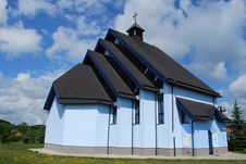Free Blue Church Against Blue Sky Royalty Free Stock Photos - 25224038