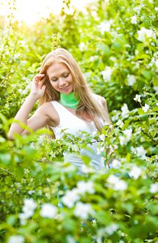 Free Beautiful Blonde Girl In The Garden Stock Photos - 25232073