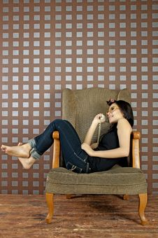 Phone And Sit On Chair Royalty Free Stock Photos