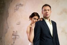 Free Bride And Groom Standing In Empty Room Stock Image - 25253571
