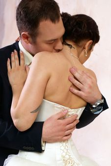 Free Groom Kisses Bride In Empty Room Stock Photo - 25253850