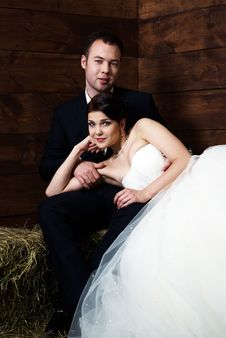 Free Bride Lying On Groom S Lap In Barn Stock Photo - 25254180
