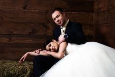Free Bride Lying On Groom S Lap In Barn Stock Images - 25254224
