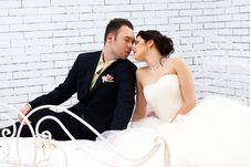 Free Bride And Groom Sitting On Bed In Bedroom Royalty Free Stock Photo - 25255565