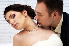 Free Groom Kisses Bride In White Room Stock Photography - 25256482