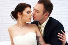 Free Groom Kisses Bride In White Room Royalty Free Stock Photography - 25256557
