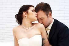 Free Groom Kisses Bride In White Room Stock Images - 25256574