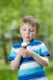 Free Happy Kid Eating A Tasty Ice Cream Outdoor Stock Photos - 25282813