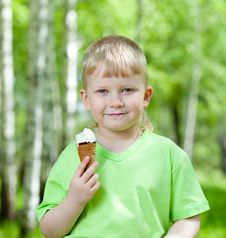 Child Eating A Tasty Ice Cream Outdoors Royalty Free Stock Image
