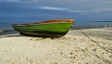 Free Fishing Boat On Sandy Beach, Latvia, Europe Stock Photography - 25282982