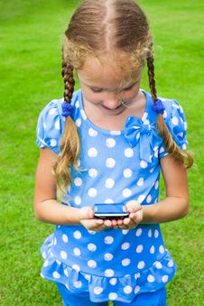 Girl Holding A Cell Phone Stock Photo