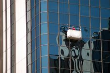 Free Window Washers On Skyscraper Stock Photography - 2530222