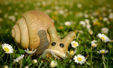 Free Toy Snail In Meadow With Daisi Royalty Free Stock Images - 2535029