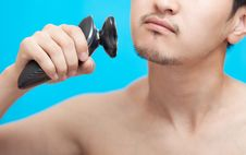 Free The Man Shaves A Cheek Royalty Free Stock Photo - 25317945