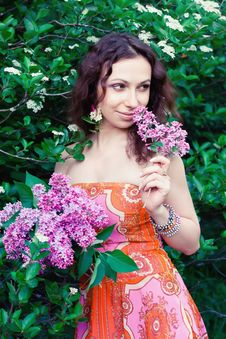 Free Woman With Lilac Flowers Royalty Free Stock Images - 25327169