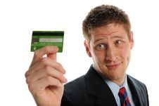 Free Young Businessman Holding A Credit Card Royalty Free Stock Image - 25328736