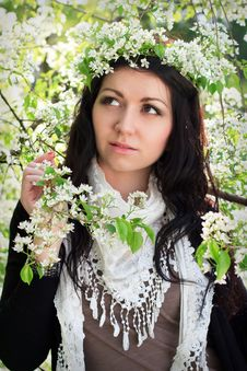 Beautiful Girl In The Flowered Garden Stock Photography