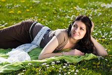 Free Beautiful Girl Lying On The Grass With Flowers Royalty Free Stock Image - 25337036