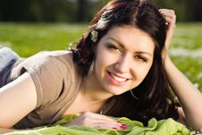 Beautiful Girl Lying On The Plaid In The Park Royalty Free Stock Images