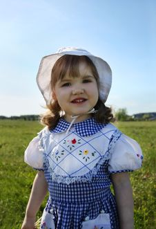 Happy Little Girl Stands On Green Field Stock Photos