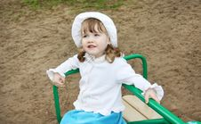 Free Llittle Girl Wearing Rides On Small Carousel Royalty Free Stock Photos - 25345938