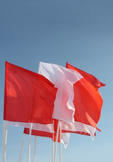 Free Red And White Flags Flutter In Wind On Blue Sky Stock Image - 25346401