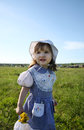 Free Little Girl Looks Into Distance On Green Field Stock Photography - 25350832