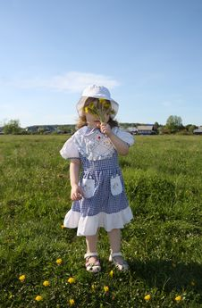 Free Little Girl Hides Her Face In Yellow Dandelions Stock Photography - 25350792