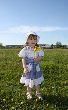 Free Happy Little Girl Holds Yellow Dandelions Royalty Free Stock Photo - 25350825