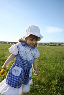 Happy Little Girl Walks On Green Field Stock Photos